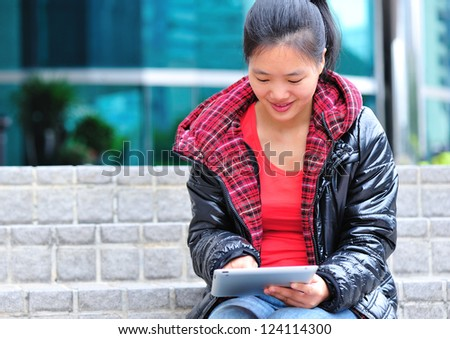 young asian woman use tablet pc - stock photo