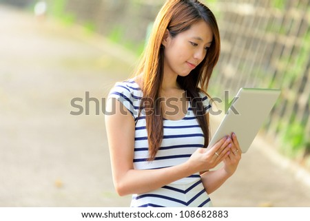 young asian woman using tablet computer