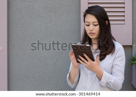 Young Asian woman using tablet pc computer
