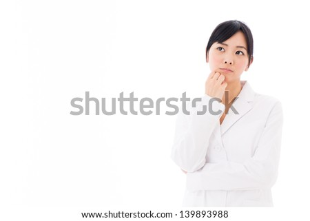 young asian woman wearing white coat thinking on white background - stock photo