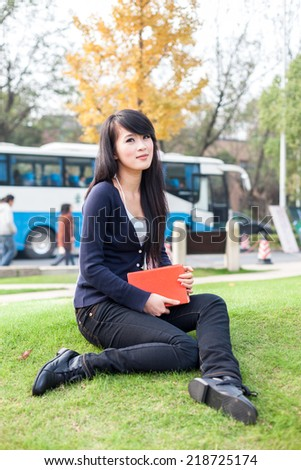 Young asian woman with a  book