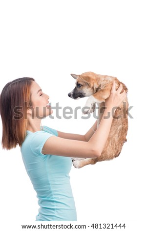 Young asian woman with a little puppy isolated over a white background