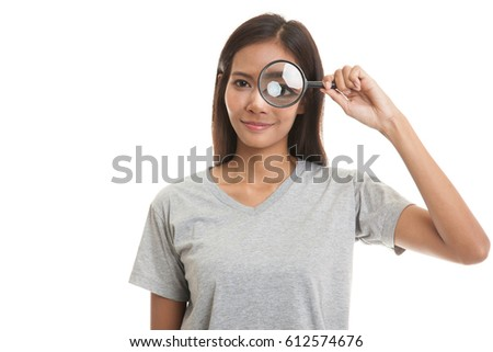 Young Asian woman with a magnifying glass  isolated on white background.