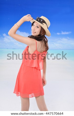 young Asian woman with hat on the beach enjoy sunlight - stock photo