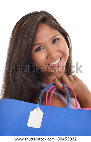 Young Asian woman with holding shopping bags with blank sale tag - stock photo