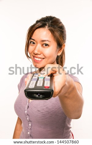 young asian woman with remote conrol - stock photo
