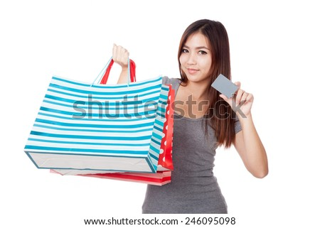 Young Asian woman with shopping bag and blank card  isolated on white background