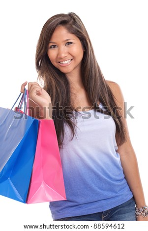 Young Asian woman with shopping bags isolated on a white background - stock photo