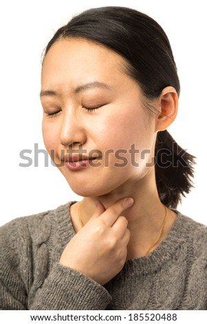 Young Asian woman with throat pain on white background