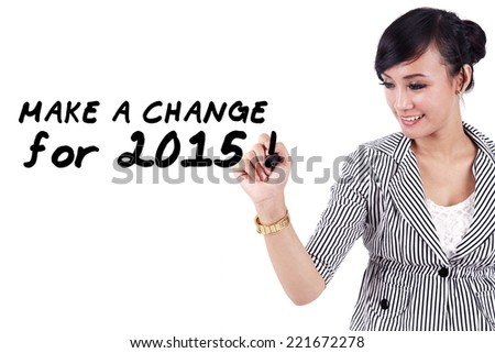 Young asian woman writes a text to make a change in 2015 - stock photo
