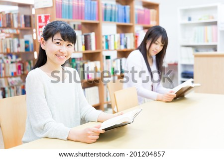 young asian women reading book in the library