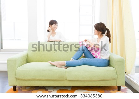 young asian women relaxing in the kitchen