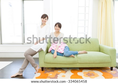 young asian women relaxing in the kitchen - stock photo