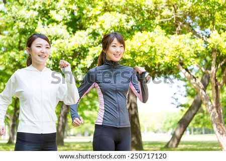 young asian women running in the park