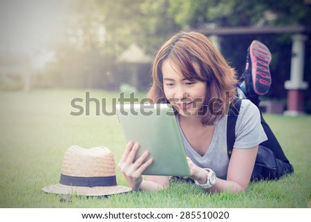 Young Asian women use Tablet for chat and massage to her friend. - stock photo