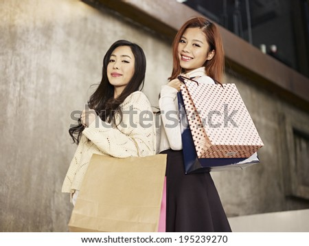 young asian women with shopping bags. - stock photo