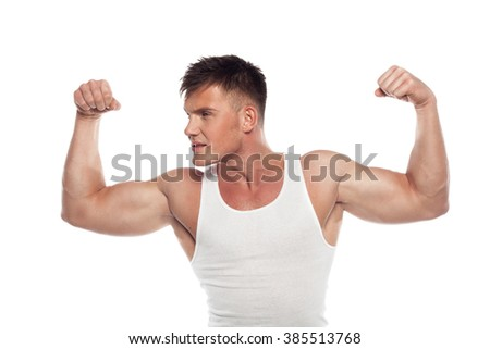 young athlete demonstrates biceps