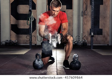 Young athlete getting ready for crossfit training - stock photo