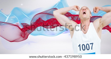 Young athlete winning race against blue design - stock photo