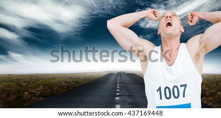 Young athlete winning race against view of an empty street - stock photo