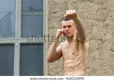 Young, athletic man doing boxing exercises / young man / boxer
