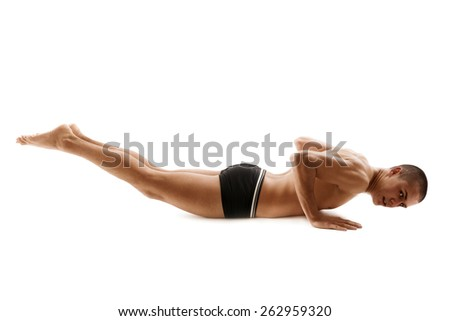 Young athletic man doing push ups. - stock photo