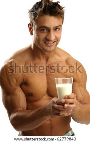 Young athletic man having milk - stock photo
