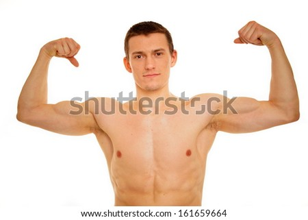 Young athletic man shirtless shows biceps muscle