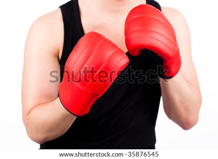 Young athletic man wearing boxing gloves