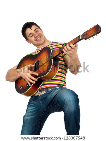 Young athletic man wearing Rainbow Gay Pride Flag color t shirt.playing the guitar.Isolated on white background