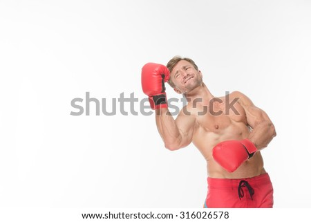 Young athletic man with boxing gloves on training isolated on white. Handsome muscular young man wearing boxing gloves. - stock photo