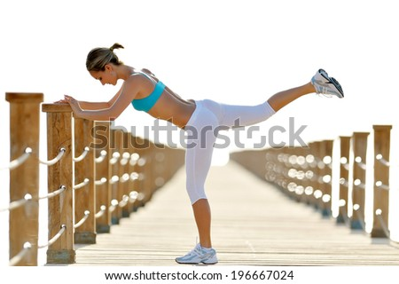 young athletic woman exercising outdoor in summer morning - stock photo