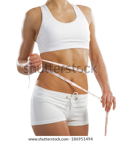 young athletic woman measuring waist measuring tape, isolated on white background - stock photo