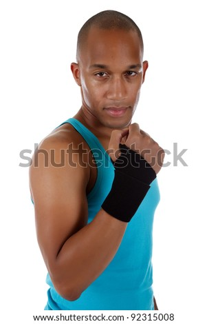 Young attractive African American man athlete wearing a wrist brace,  bandaged. White background. Studio shot. - stock photo