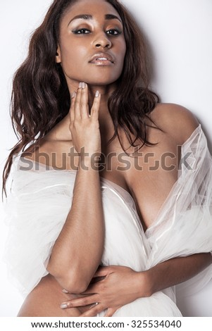 Young attractive African-American model with long hair. - stock photo