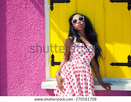 Young attractive african american woman wearing sunglasses - stock photo