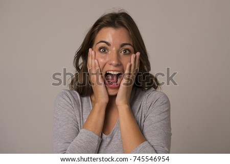 young attractive and beautiful woman screaming excited and happy in nice shock and surprise showing positive and friendly face expression in happiness emotion concept