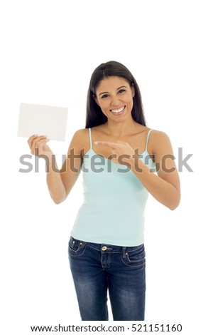 young attractive and happy hispanic woman holding blank card with copy space isolated on white background in advertising concept