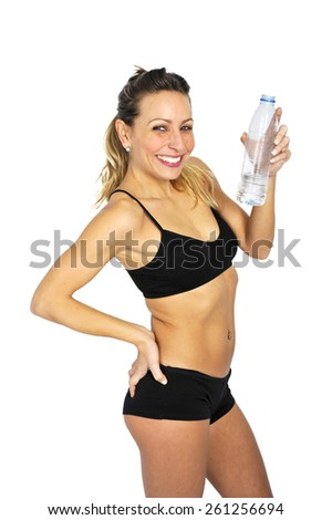 young attractive and sexy blond hair woman in sport top bra drinking bottle of water in diet, fitness, health , healthy lifestyle and exercise concept   - stock photo
