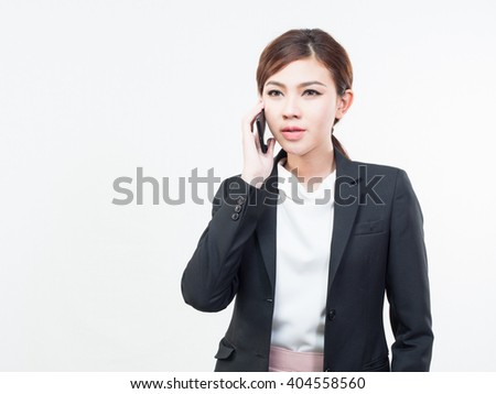 Young attractive Asian business woman use mobile phone on white background. - stock photo