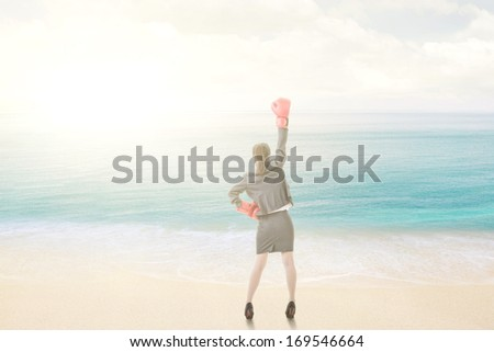 Young attractive asian business woman with boxing gloves are ready for battle. Rear view.  - stock photo