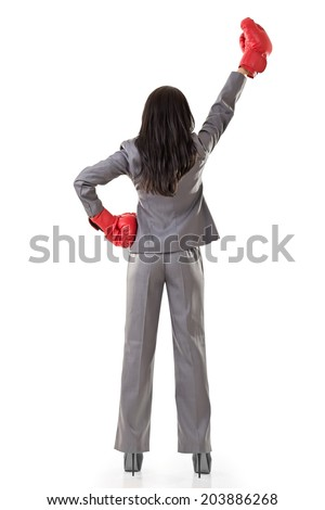 Young attractive Asian business woman with boxing gloves are ready for battle. Rear view. Isolated on the white background. - stock photo