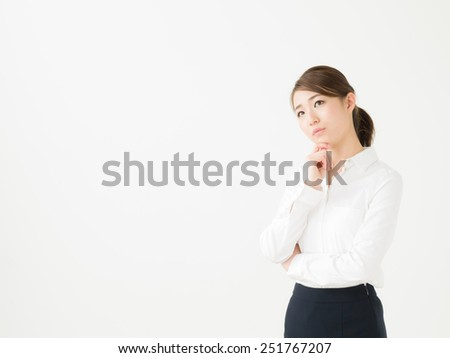 young attractive asian businesswoman who is troubled