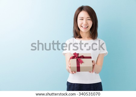 young attractive asian woman having a present - stock photo