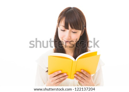 young attractive asian woman who reads a book