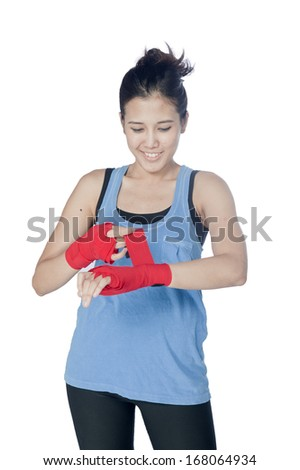 Young attractive asian woman with boxing gloves are ready for battle. Isolated on the white background.
