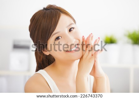 Young attractive asian woman with clean skin - stock photo