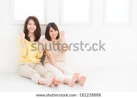 young attractive asian women  to see a smart phone - stock photo
