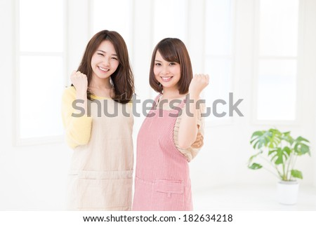 young attractive asian women who cooks - stock photo