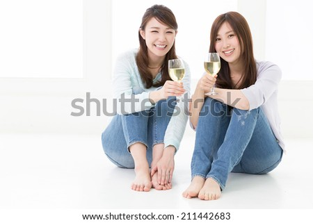 young attractive asian women who drinks wine